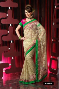 full net designer saree with green border, this saree comes with lovely pink blouse