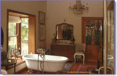 like the cozy feel of this antique bathroom...especially the claw foot tub