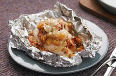 Foil-Pack Bruschetta Chicken Bake recipe - I'm sure this would have worked just fine if I had an oven, but it was too much for my toaster oven.  I ended up using a dish - chicken in bottom, stuffing/tomato mix on top, covered w/foil and baked.  Very tasty.  Easy to prepare.  Would try it again.