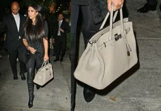7f3d65e6b1a5 Kim Kardashian showing off one of her many Hermès Birkin bags while leaving  dinner with her family in LA.