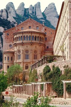 The Benedictine monastery of Santa Maria with the Montserrat Mountain behind. Near Barcelona, Spain.