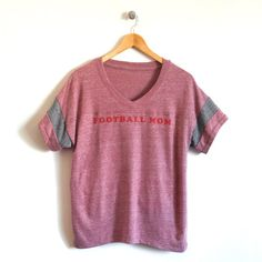 Sports Mom Football Jersey T-shirt – cloudandclover  The perfect graphic tee for cheering on your littles during the big game!