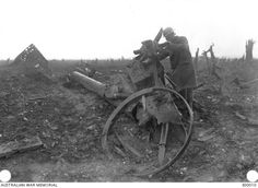 An Australian soldier examining the remains of a German 5.9 inch gun in the Copse at Pozieres, in France, in October 1916. This position was taken some months earlier by the 3rd and 11th Battalions, AIF