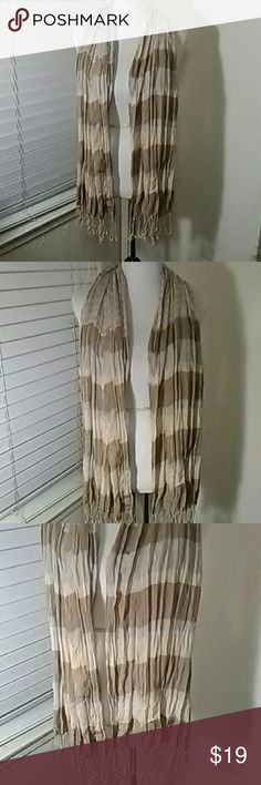 Beige striped scarf with fringes This is bnwot, it's a beige and gray striped scarf. Has 3 inch Fringes also bottom. Wide across. 60% rayon and 40% poly Accessories Scarves & Wraps
