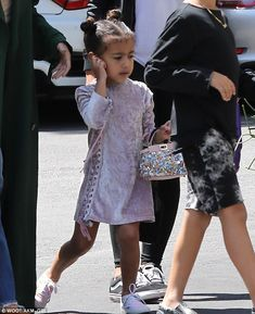 Chic:Kim Kardashian and Kanye West's daughter North is naturally inclined to steal some designer style, as illustrated on Sunday when she headed to church with her aunt Kourtney alongside cousins Mason, seven and Penelope, four