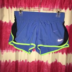 "Nike Women's running shorts NEVER WORN (without tags) Women's Nike Dri-Fit 3'' dash solid running shorts. Color is a sky blue with lime green trim. Inside has strings to tighten fit around waist. Received these as a Christmas gift (reason for no tag) and they did not fit. Never returned. Run a little small for a ""small"" if you have wide hips and/or a little booty. Nike Shorts"