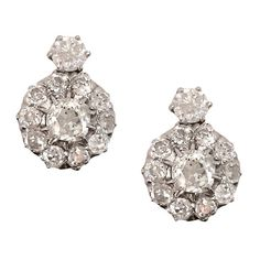 6.5 Carat Diamond Platinum Cluster Earrings   From a unique collection of vintage stud earrings at https://www.1stdibs.com/jewelry/earrings/stud-earrings/
