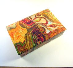 Decorative box in striking multicolored marbled paper for display or storage of  treasures or necessities