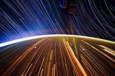 Long exposure photograph by NASA astronaut Don Pettit: star trails and city trails