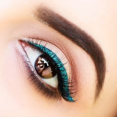 Green glitter eye makeup look. Love!!!!