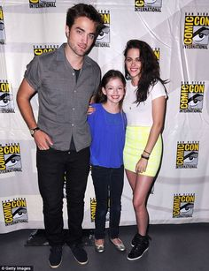 One big happy family: Robert Pattinson and Kristen Stewart with their on-screen daughter, Mackenzie Foy