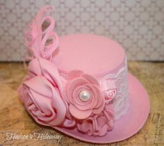 Pink and white lace and pearl mini hat fascinator. Felt and rolled flowers with nagorie feathers