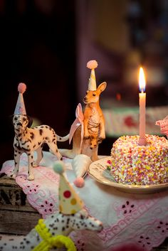 Cutest party animals ever! There's even a kangaroo. Animals with party hats table decoration by Cutest Cottage Overload
