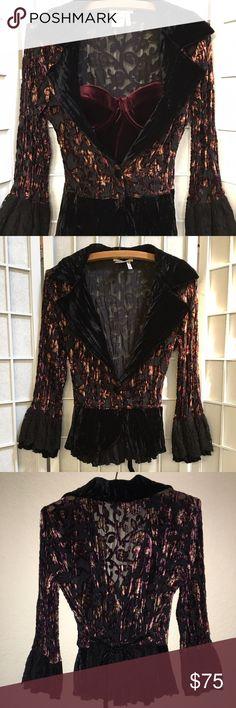 Alberto Makali Velvet Blazer Designer Alberto Makali velvet goth/vampire style blazer. Dark maroon gold highlights in material. Flared sleeves made of velvet & lace. Back of blazer is also velvet & lace with a slight bustled look when wearing. Material is light to wear. Size is large fits more like a medium. All buttons & snaps in tact. (Velvet bustier not included). #goth #vampire #velvet #maroon #black #wrap #blazer Alberto Makali Jackets & Coats Blazers