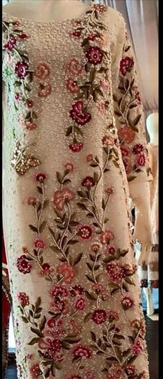 Sania Maskatiya | cream-white dress with red and green rose embroidery | Pakistani fashion