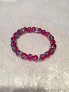 I have created this pretty stretch bead bracelet with 8 mm two tone cerise pink and light blue crackle glass beads Would fit a 5.75″to 6.25″ wrist Presented in an organza gift bag