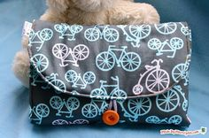 Sew an all-in-one changing mat with this free video tutorial. This clutch holds diapers and wipes, and unfolds into a changing mat for baby!