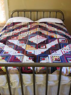Google Image Result for http://oldquiltcompany.com/log-cabin-on-bed.jpg