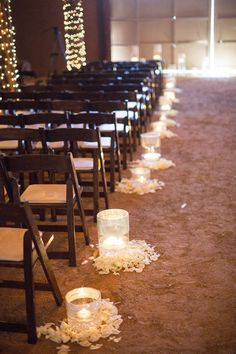 Decorate your wedding aisle with floating candles in a vase and silk flower petals. This is a lovely rustic wedding decoration idea
