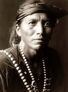 Here for your perusal is a one-of-a-kind photograph of White Singer. It was created in 1906 by Edward S. Curtis.    The photograph illustrates a Head-and-shoulders portrait of Navajo man, facing slightly right, wearing headband and silver squash blossom necklace.