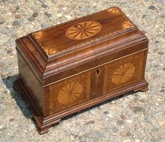 Antique Inlaid English Tea Chest This antique english tea chest measures 6 and one half inches high, by 10 inches wide, and is 5 and one half inches deep front to back. The inside is approximately 3 and one half inches deep.