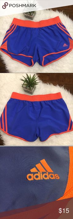 "Bright Summery Adidas Athletic Shorts Great used condition. Vibrant blue and orange athletic shorts from Adidas. Size medium. Waist flat: 14 1/2"", waist to hem: 13"". These do not have built in underwear lining. Please see picture of A on adidas logo with some peeling. No holes or stains. Smoke free home. No trades please adidas Shorts"