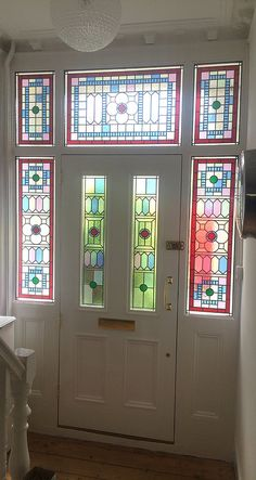Solid wood Victorian front door with stained glass.