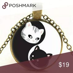 "Yin and Yang Kitty Cabochon Necklace Super cute necklace for everyday wear. Sweet cartoon kittens form the yin and yang Chinese symbol. Pendant 1"" with silver tone chain. NWT The ubiquitous yin-yang symbol holds its roots in Taoism/Daoism, a Chinese religion and philosophy. The yin, the dark swirl, is associated with shadows, femininity, and the trough of a wave; the yang, the light swirl, represents brightness, passion and growth. Cats anime kawaii Jewelry Necklaces"