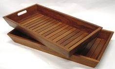 Set of 2 Nesting Solid Teak Serving & Storage Trays- Indoor, Outdoor by Aqua Teak. $84.95. Use for decorative storage of towels, toiletries, center pieces, spices. Nesting stacking set of two solid teak serving, amenity, or storage trays. Solid teak contemporary look looks equally well formally or informally. Versatile- serving, bedroom, bathroom, patio, pool area, kitchen. Top Tray:  25 x 13.5 x 2.5   Bottom Tray:   24.25 x 12.5 x 2.5. Set of two solid teak nesting se...