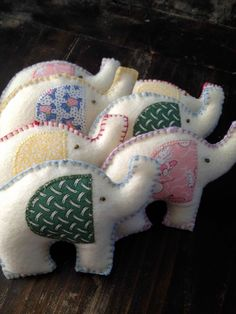 More felt elephants - the coloured blanket stitching is a cute touch.
