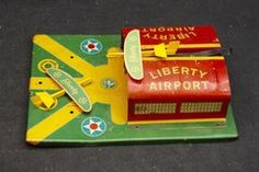 ANTIQUE LIBERTY PRESSED STEEL AIRPORT HANGAR PLANE LAUNCHER TOY ca.1935
