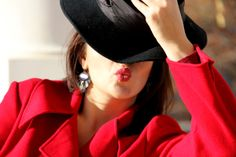 Lovely dark grey earrings, a black hat and sweet kiss.  Love is energy and life. We are love - Style Advisor