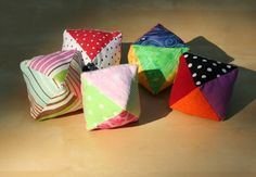Reverse engineer these...different fabrics (tactile/sensory), crinkle/bell/rattle inside?