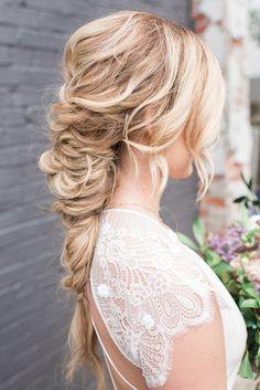 braided wedding hair - photo by Holly Von Lanken Photography http://ruffledblog.com/romantic-modern-minimalist-wedding-inspiration
