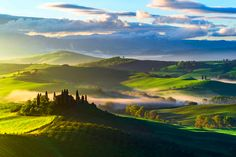 Download Wallpaper the sky, clouds, trees, fog, hills, field, morning, Italy, estate, Tuscany, section пейзажи Resolution 2048x1367