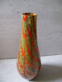 Murano glass vase by Eugenio Ferro. 21st century, Italy Special beautiful Murano vase.  Signed by glass master Marino Santi  High 37 cm.  Wide 14 cm.  Mint condition with certificate of authenticity. Price 650 euros