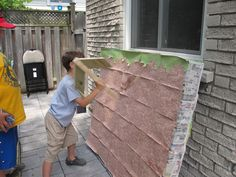 Minecraft block pinata wall. I used 30 fruitopia boxes all taped together, cutting an x in each box so it wouldn't just collapse when hit. I put treats and surprises in some of the boxes. Then I put a layer of paper mache over the whole thing and covered each block with a printout of the dirt pattern. The kids had so much fun picking out a block and mining the heck out of it! http://ww.minecraftmuseum.net/view.php?i=7524 (thanks brianlechthaler-37) *I adjusted the colour to get brown