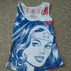 Wonder Woman tank top Excellent condition. No holes. No stains. True to size.  Single item offers thru offer tab ONLY/bundles receive 15% off ❌No trades ❌No other sites ❌No pay pal DC Comics Tops Tank Tops