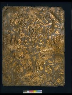 Embossed gilt leather panel with three human figures between foliage and two quarters of a feston. The embossed pattern consists of swags of scrolling foliage, tulips, roses, sunflowers and other flowers, grapes, pomegranates, berries, melons, pears, plums and other fruit, amid which are Bacchus, Ceres and another human figure, and a bird pecking fruit above his head. ca 1650-1670, Amsterdam | Heuvel, Martinus van den (the younger) | V Museum, London