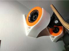 I have made this wall mount for my electric longboard Yuneec e-go that has the wheels of 90mm of diameter.