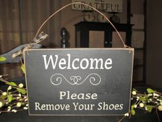 Welcome Please Remove Your Shoes Primitive Style Wood Sign. $12.00, via Etsy.