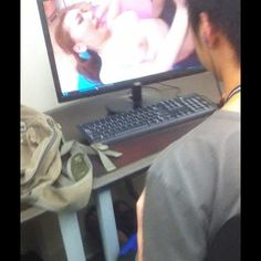 Photo by sir_dasilva  [Guy] watching porn in the library