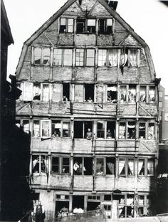 1904 - Hamburg, Germany:  House and people living in it.  Photograph by Hans Breuer