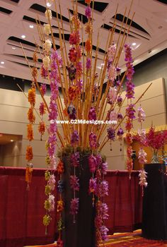 Bamboo with orchid garlands in zinc urn. Designed by: Christine McCaffery http://c2mdesigns.com