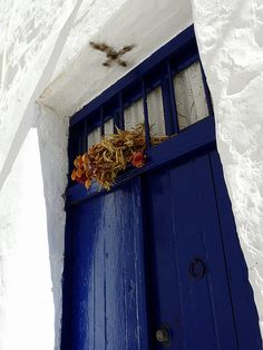 Greek Island Door - deep blue doors and bright white house.cross above the door. Greeks do this on Easter Midnight services with the smoke of the candle brought home from church. Greek Blue, Cool Doors, Unique Doors, Greek Easter, Wooden Front Doors, Cultural Architecture, Door Knockers, Door Knobs, Greek Islands