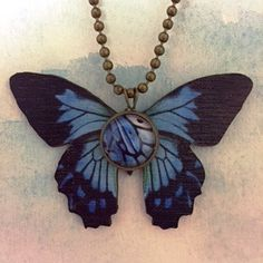 "Blue Morpho Wood Butterfly with Glass Cabochon Pendant created by Karen Minkel for ""Fly To Me"" at flytomeshop.etsy.com $15.95 each."