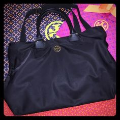 Tory Burch Dena Nylon Convertible Tote Back Nylon body with Saffiano leather handle trim. Signature logo on front, gold tone hardware, magnetic closure, optimal shoulder strap. Interior cellphone pocket, accessory pocket and zipper compartment. Tory Burch Bags Totes