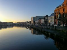 Cork is the second largest city in Ireland. It is located in the south of Ireland, on the River Lee that separates into two canals and forms an island in the center of the city. Separates, Wander, Cork, New York Skyline, Ireland, Two By Two, Places To Visit, River, Explore