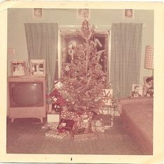 A 60's Christmas....epic! I think my mother has a photo of her in front of this same tree LOL
