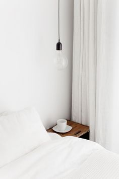 Bare bulb pendant lamps as bedside lighting | Image by Jakob Nylund